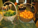 baskets of avocados and oranges